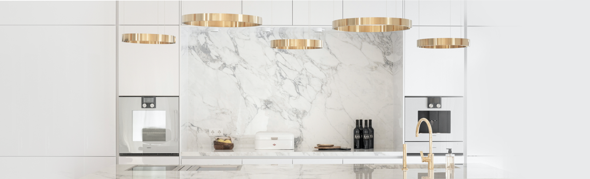 Modern white, gold and marble kitchen with Gaggenau appliances